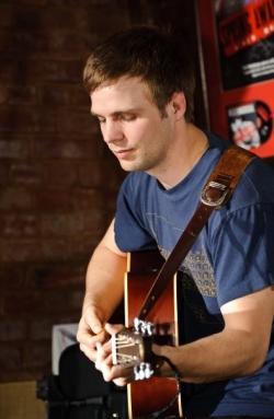 Tom Playing Guitar